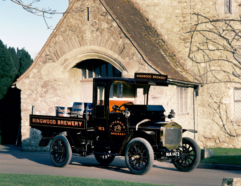 A 1914 Albion A14 flatbed truck outside the Domus at Beaulieu
