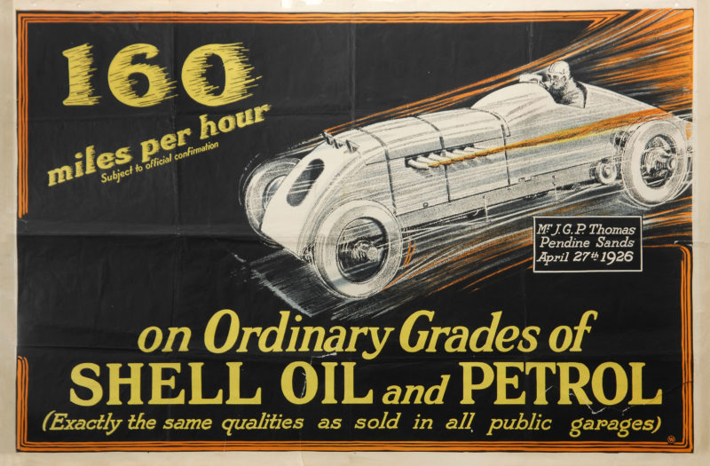 """Shell poster number 124, 160 Miles Per Hour – J.G.P. Thomas, Shell Studio (1926). Drawing of JG Parry Thomas in his vehicle, attempting to break the World Land Speed Record. Text reads; """"160 miles an hour (subject to confirmation) on ordinary grades of Shell Oil and Petrol (Exactly the same qualities as sold in all public garages). Text box reads; """"Mr J.G.P. Thomas, Pendine Sands, April 27th 1926""""."""