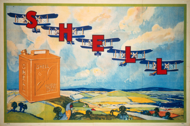 Shell poster number 3, 5 aeroplanes (1920) by Shell Studio. Poster shows five planes flying over the countryside, each with a letter from S-H-E-L-L, illustrating Shell Aviation Motor Spirit. There is an orange Shell Aviation Motor Spirit can in the foreground.