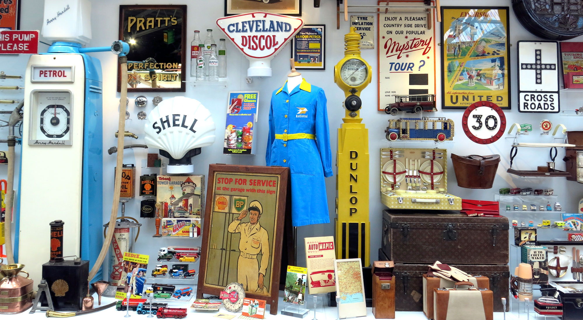 A museum showcase containing early motoring objects