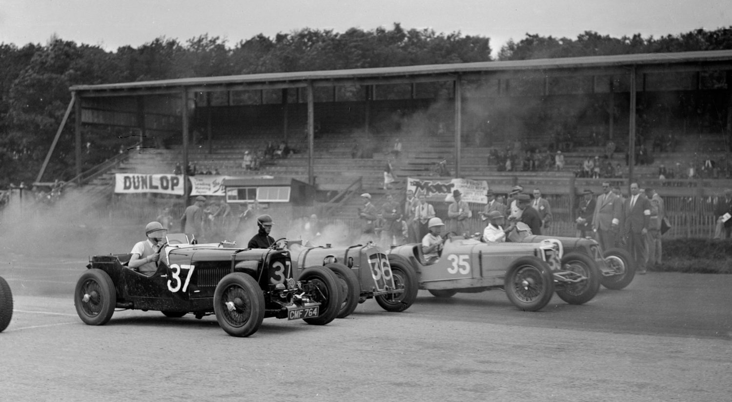 An Aston Martin, Vale Special and a Riley at a 1936 race meeting at Donington Park
