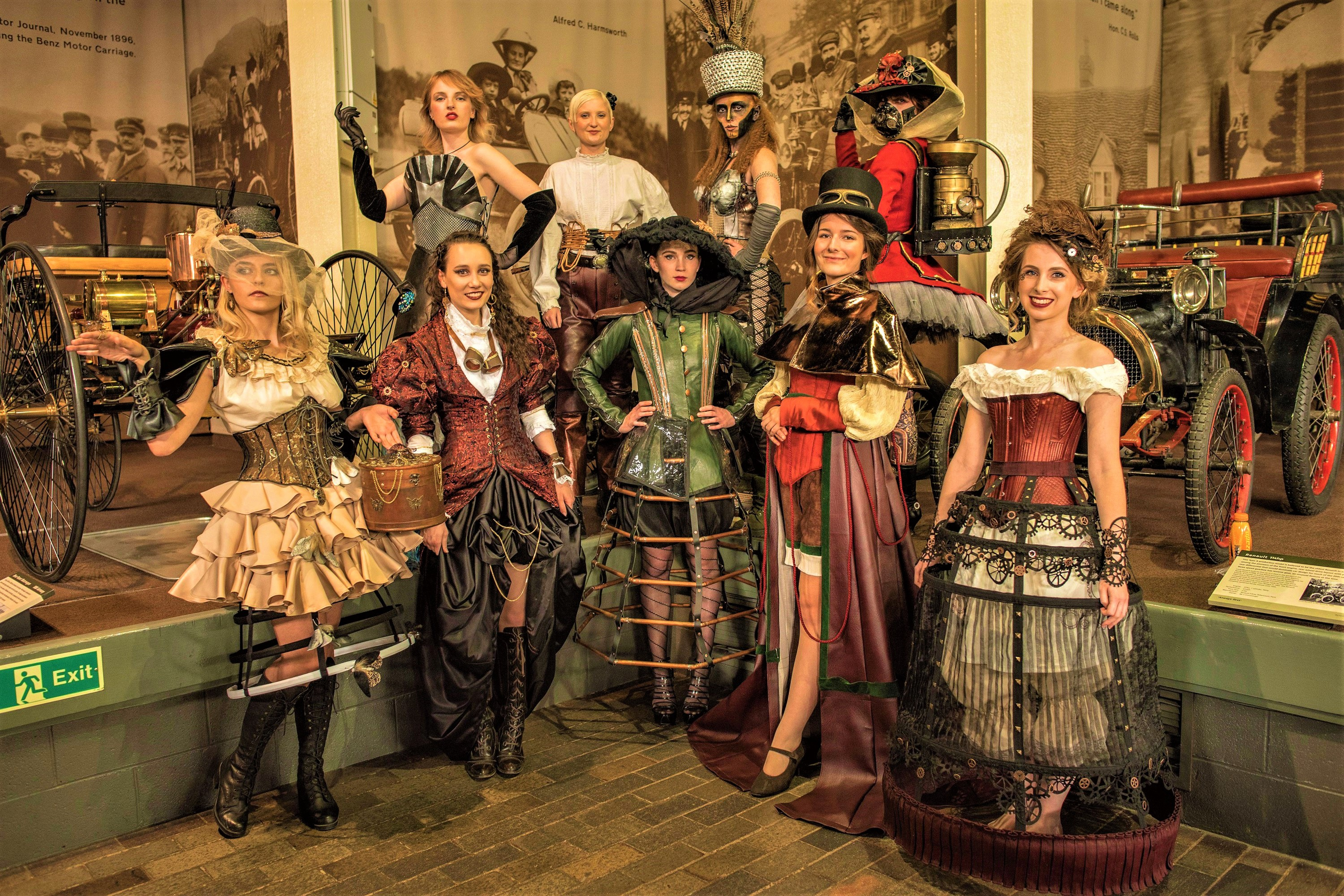 Students modelling steampunk costume at the National Motor Museum