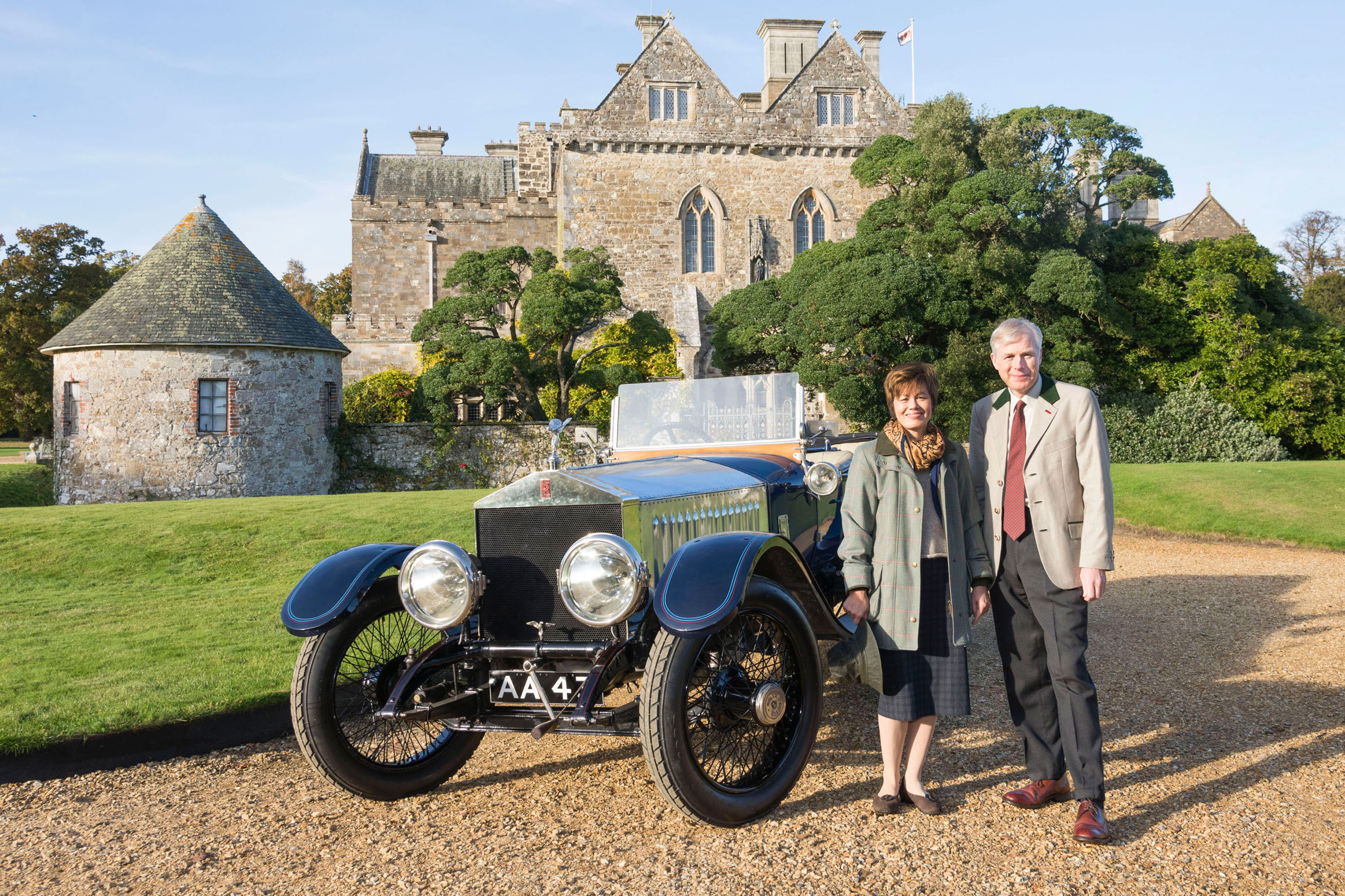 Lord and Lady Montagu with the 1914 Rolls-Royce Alpine Eagle outside Palace House