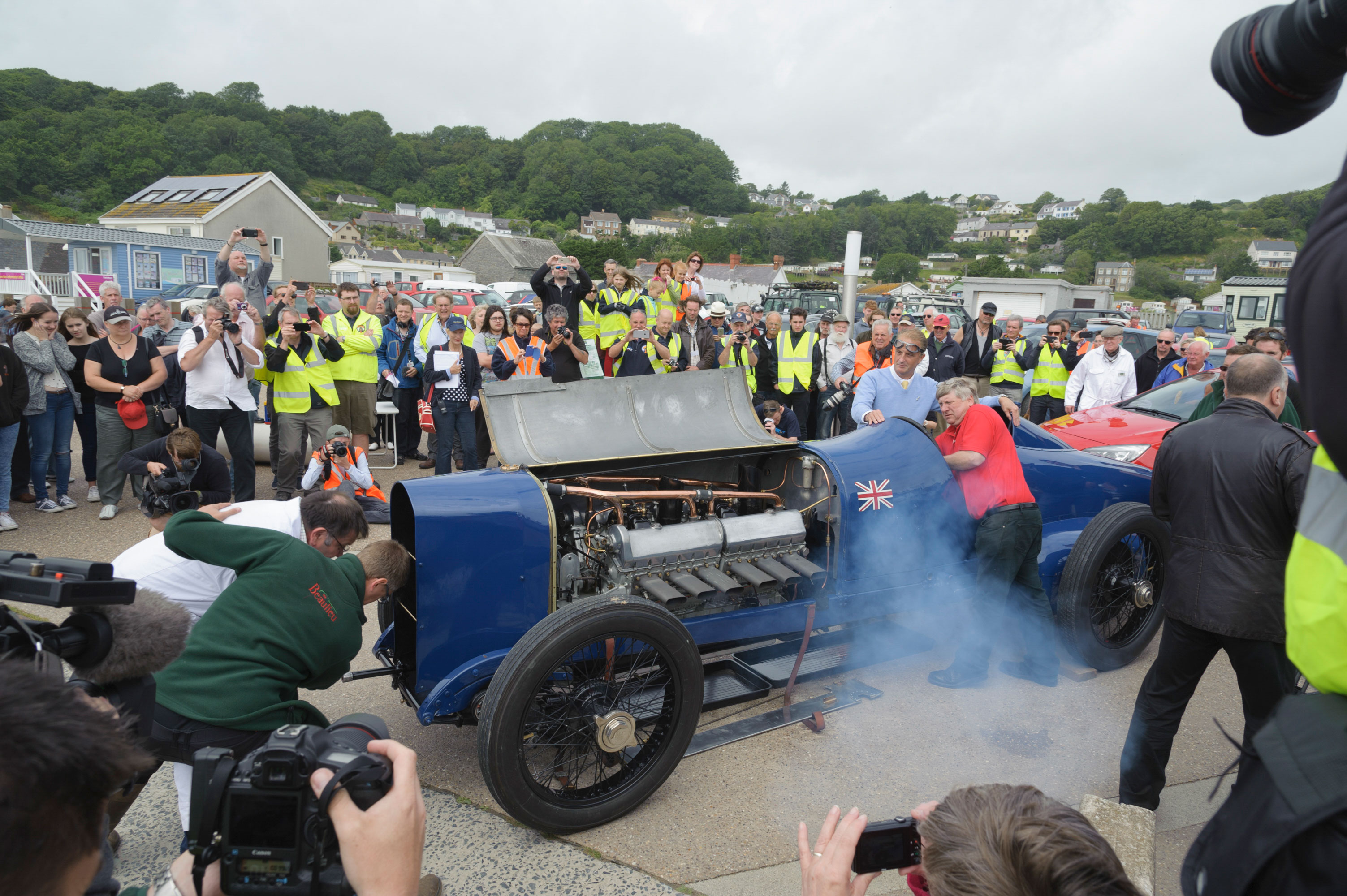 A crowd of people surround the Sunbeam 350hp as it is started up at Pendine