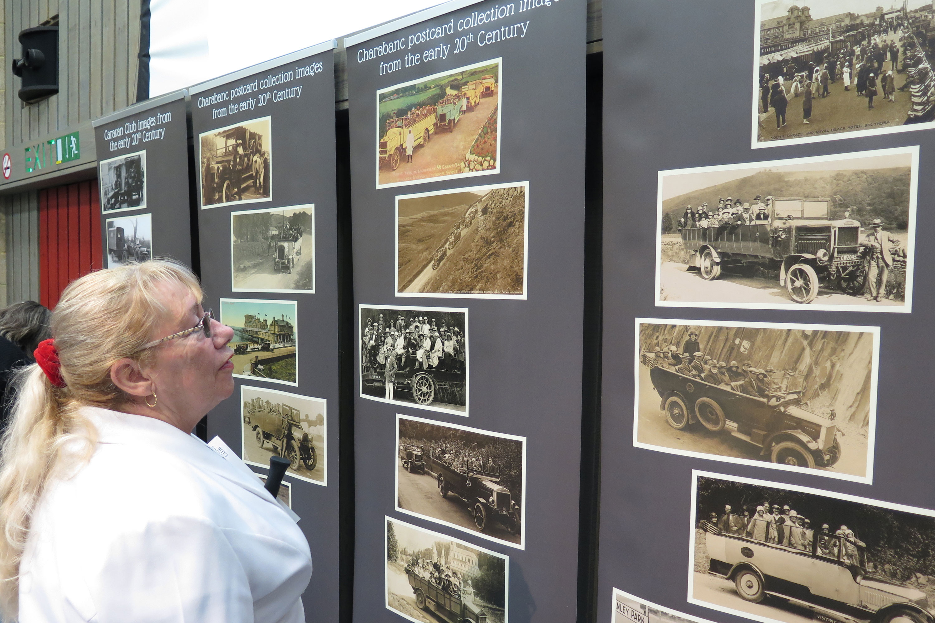 Lady looking at charabanc exhibition panels