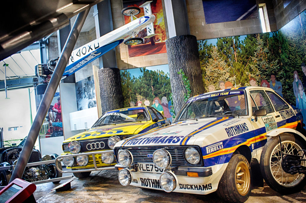Rally cars in the Chequered History exhibition at the National Motor Museum