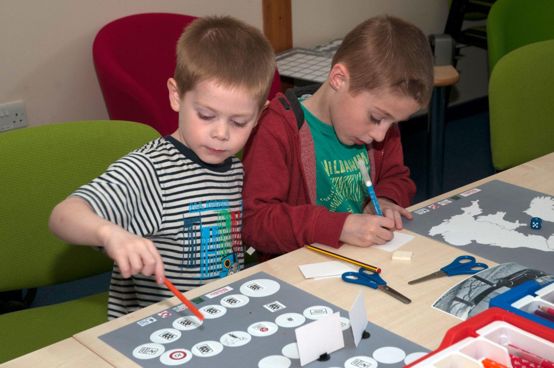 Two boys take part in a creative fun workshop