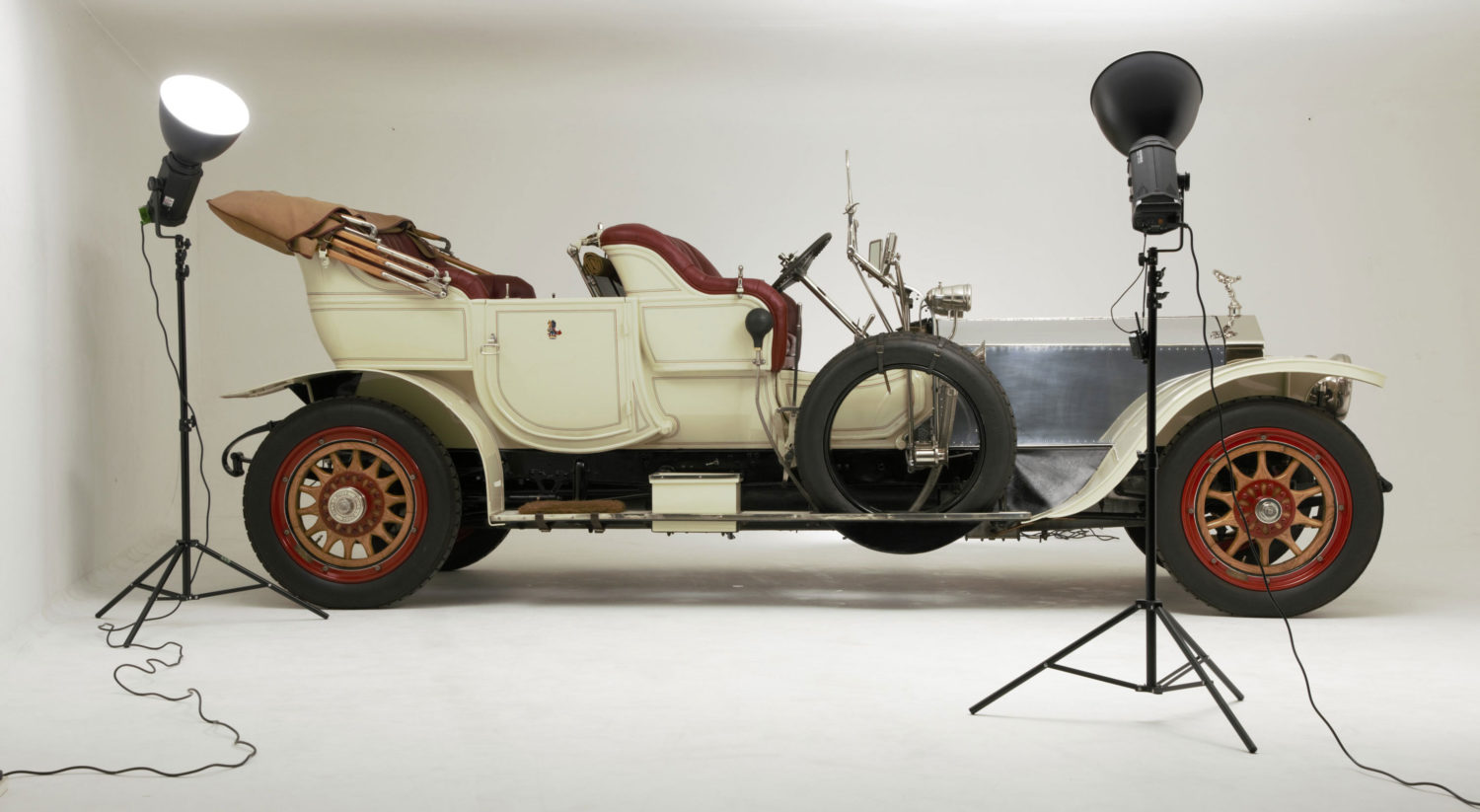 A Rolls-Royce Silver Ghost being photographed in a studio