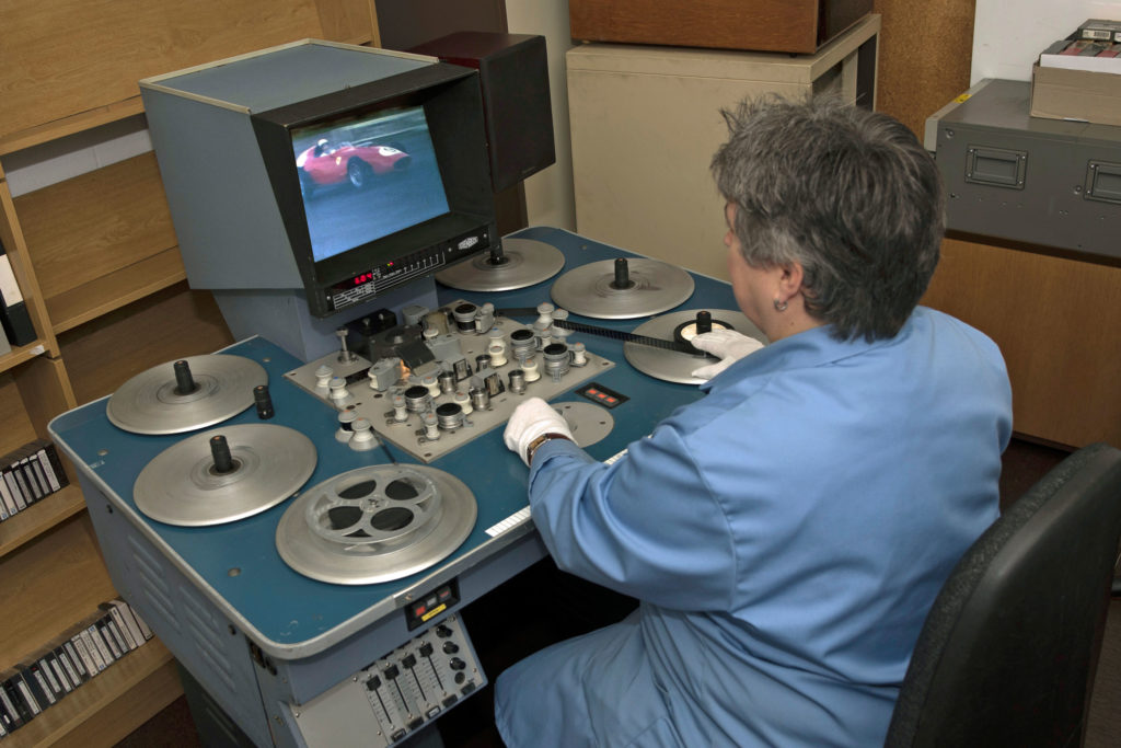 A museum curator using a Steenbeck film editing suite