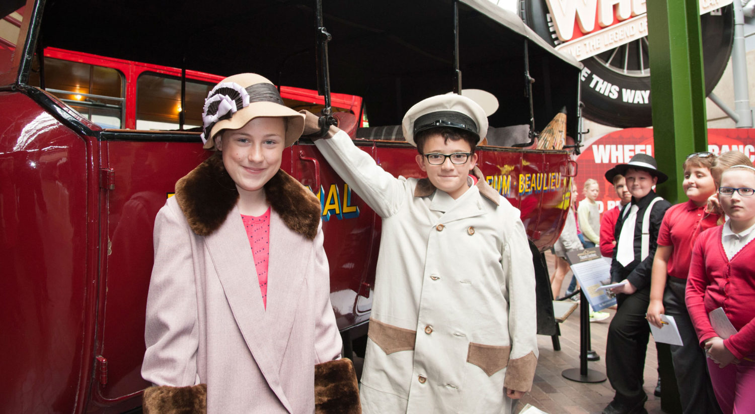 Children in costume by the 1922 Maxwell Charabanc at the National Motor Museum