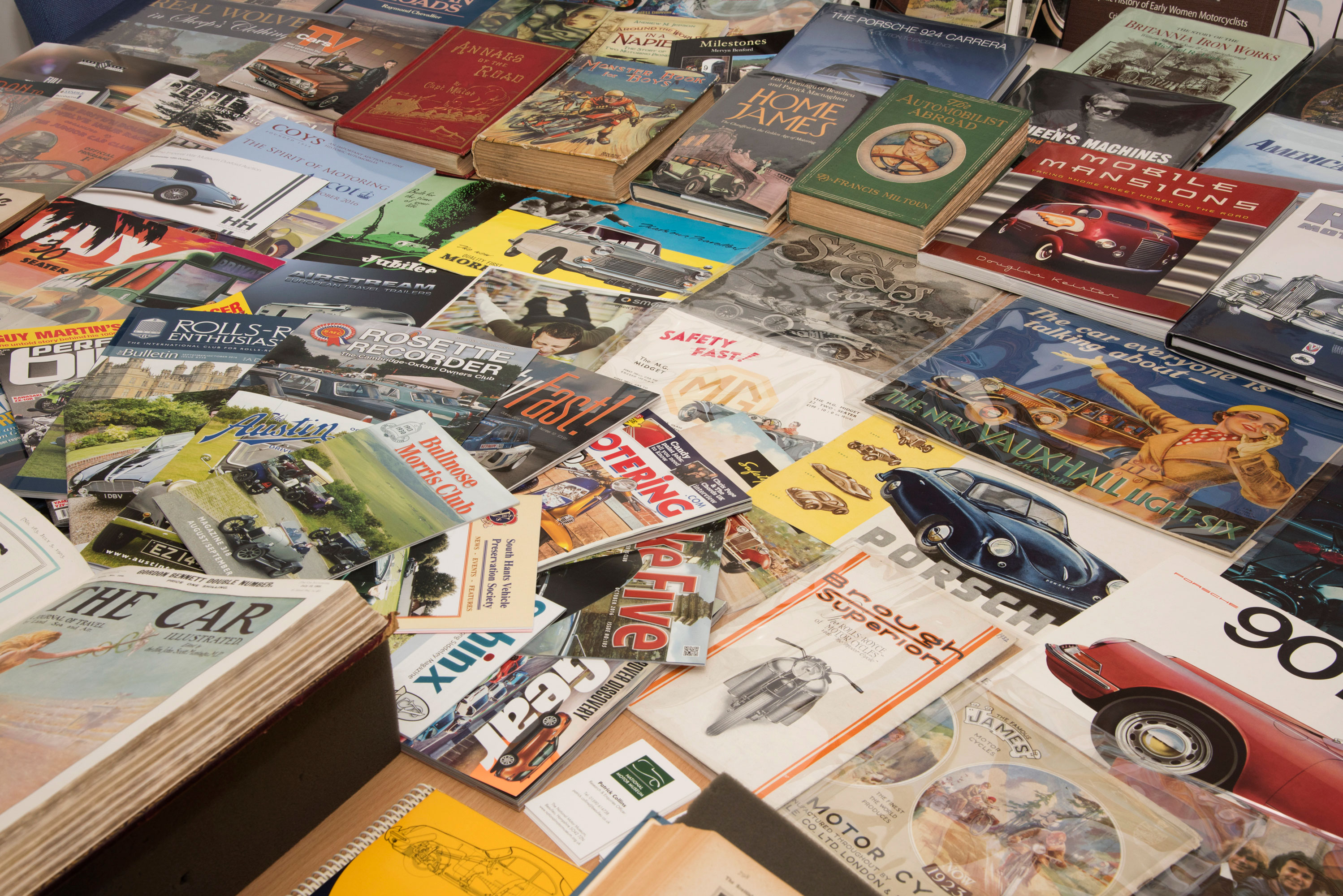 A collection of historic motoring magazines and books