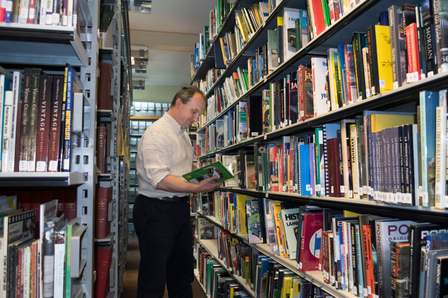 A researcher looking at a book in the National Motor Musteum Trust's library