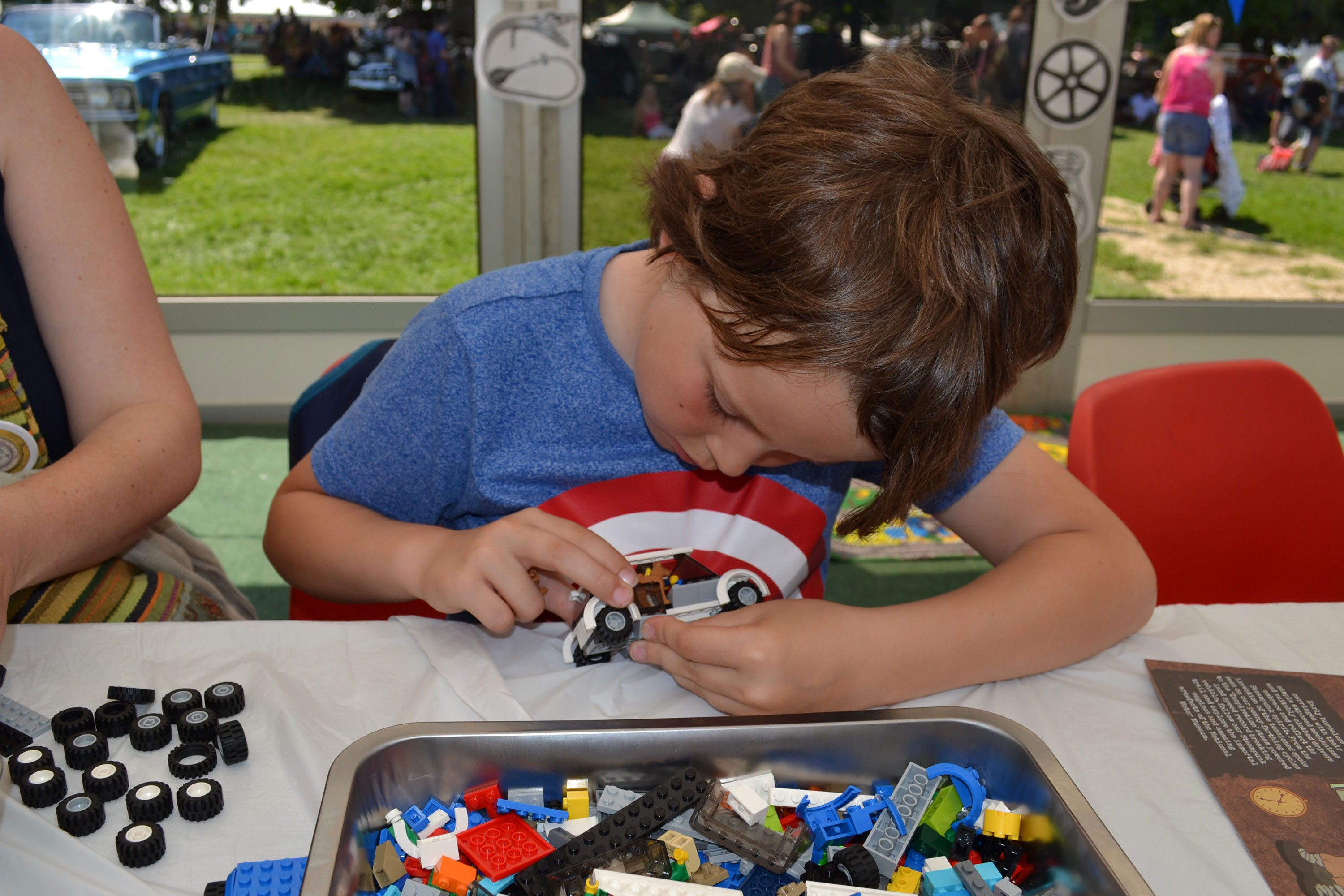 Boy making lego in a steampunk creative fun workshop at Beaulieu