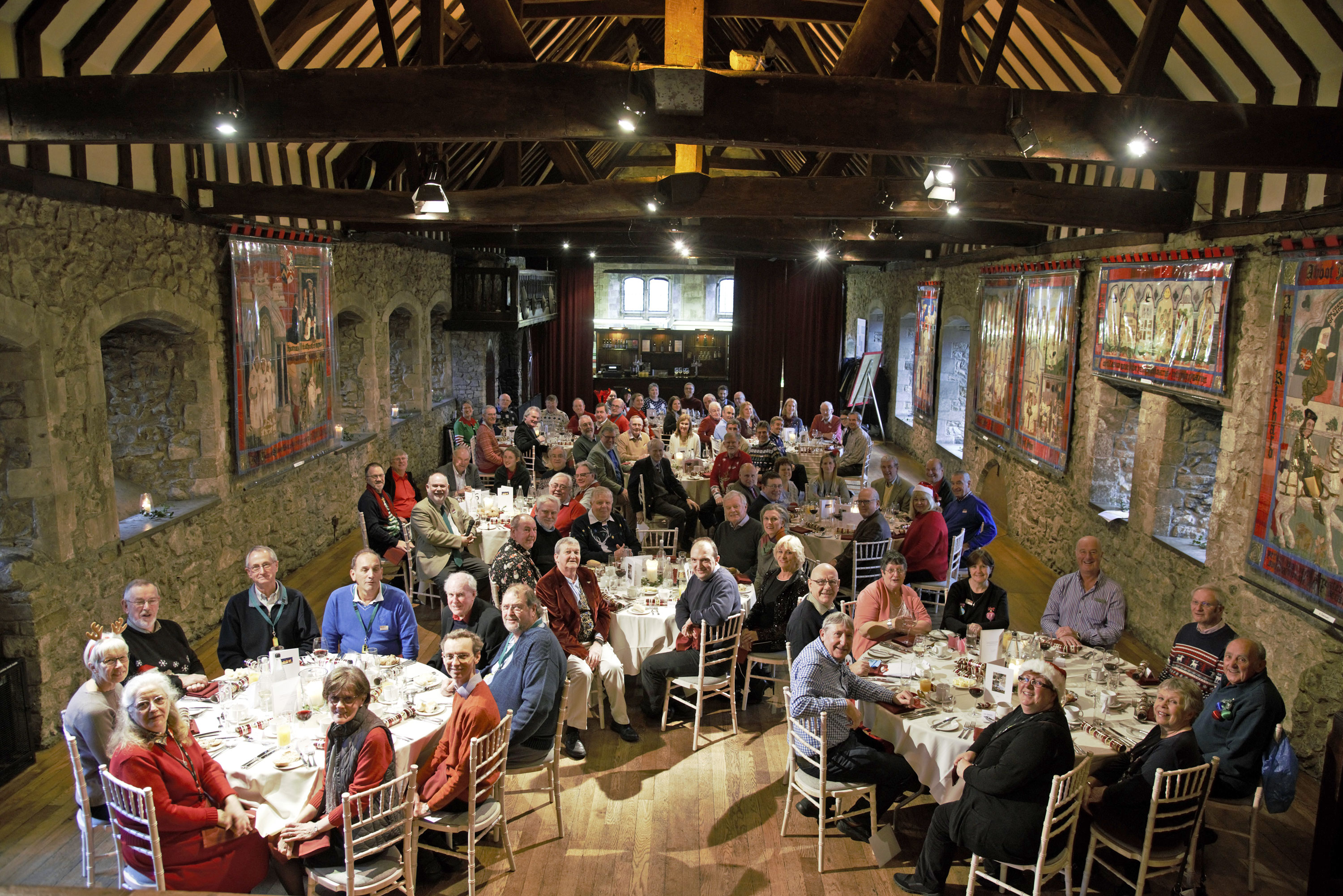 Volunteers enjoying Christmas dinner in the historic Domus at the National Motor Museum