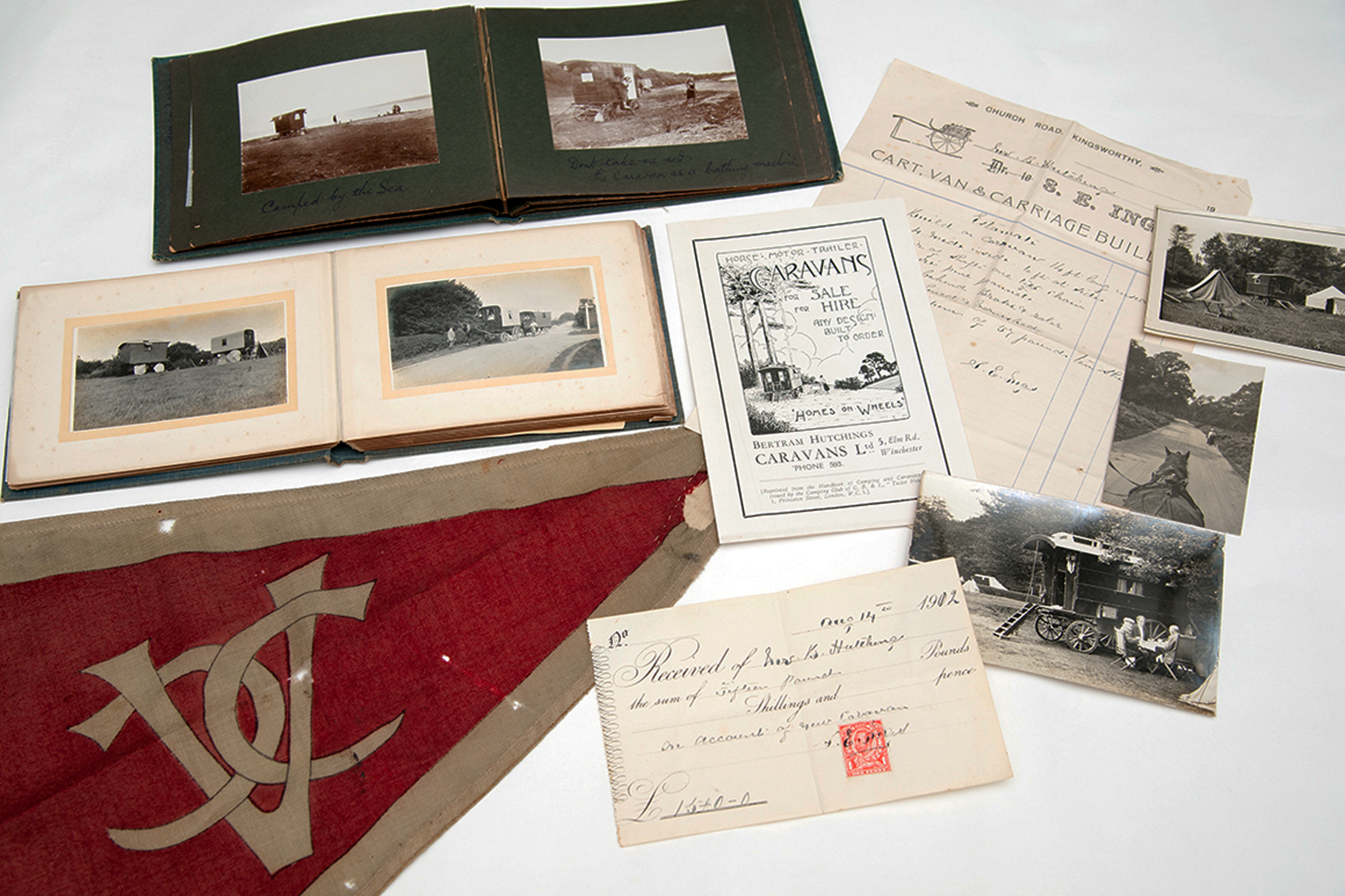 A collection of photo albums, a flag and documents