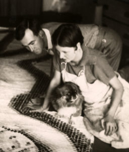 Black and white photograph of Rosemary & Clifford Ellis looking at one of their mosaics. Image courtesy Bath Record Office