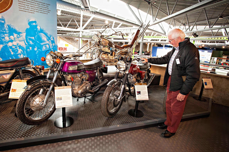 Man looking at motorcycles at the National Motor Museum