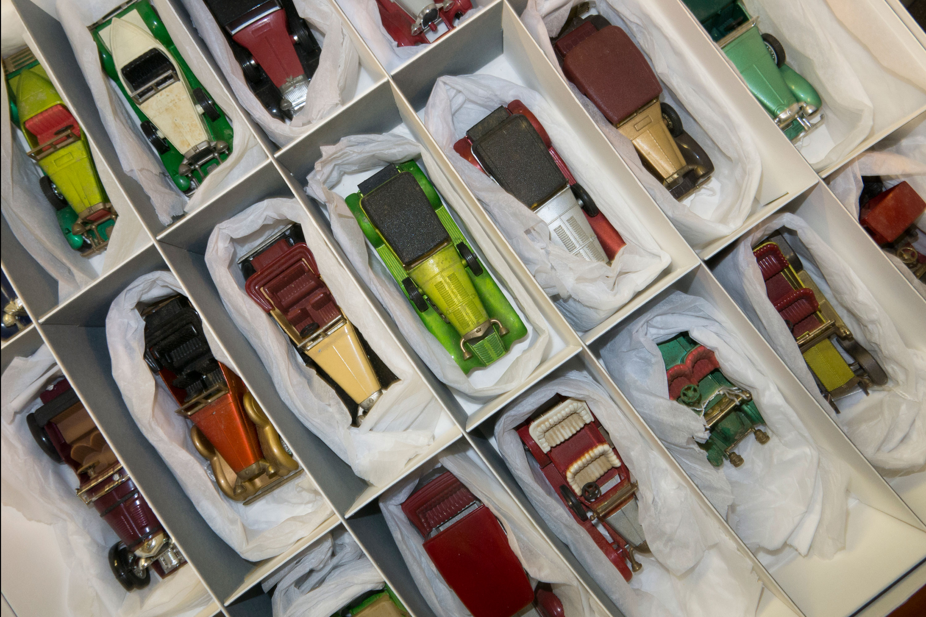 Old model cars in storage boxes at the National Motor Museum