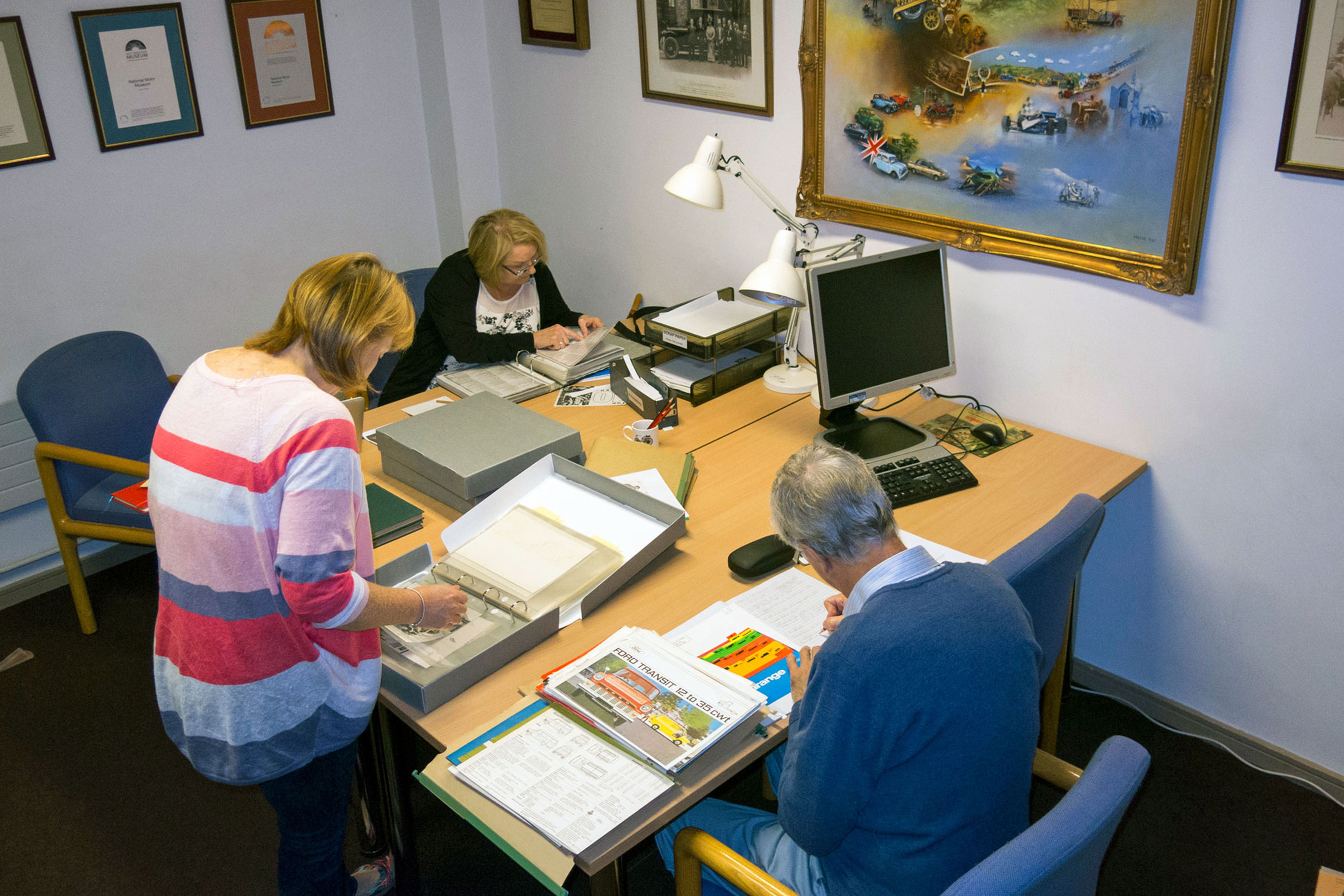 Group of researchers in the Reading Room at the National Motor Museum