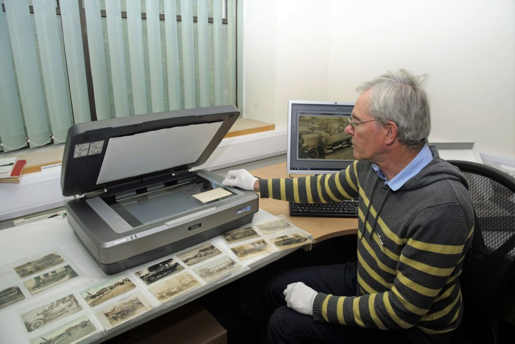 A museum volunteer scanning a historic photograph