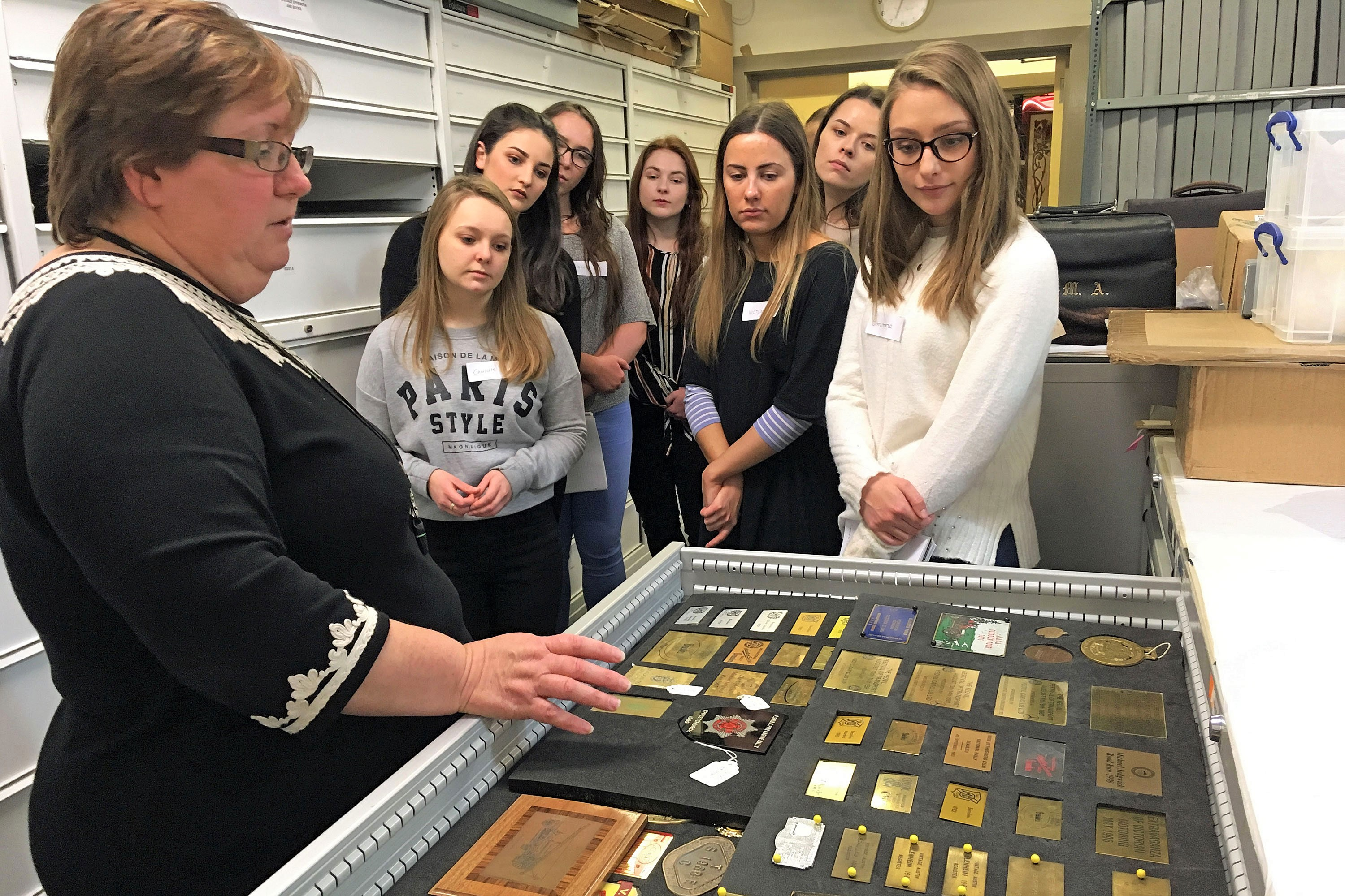 A group of students looking at objects in the National Motor Museum Collections Centre