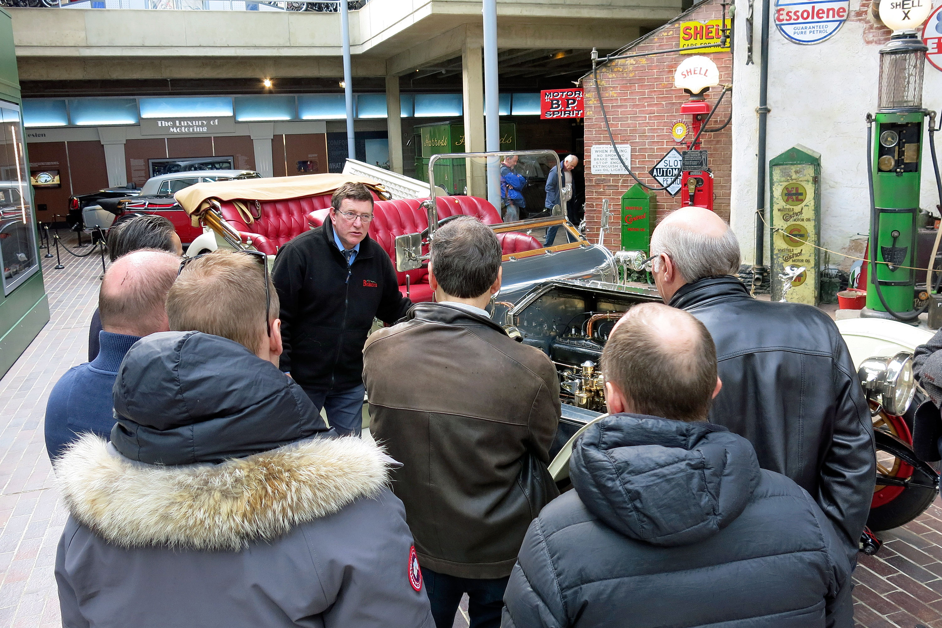 Group of people on a guided tour of the National Motor Museum