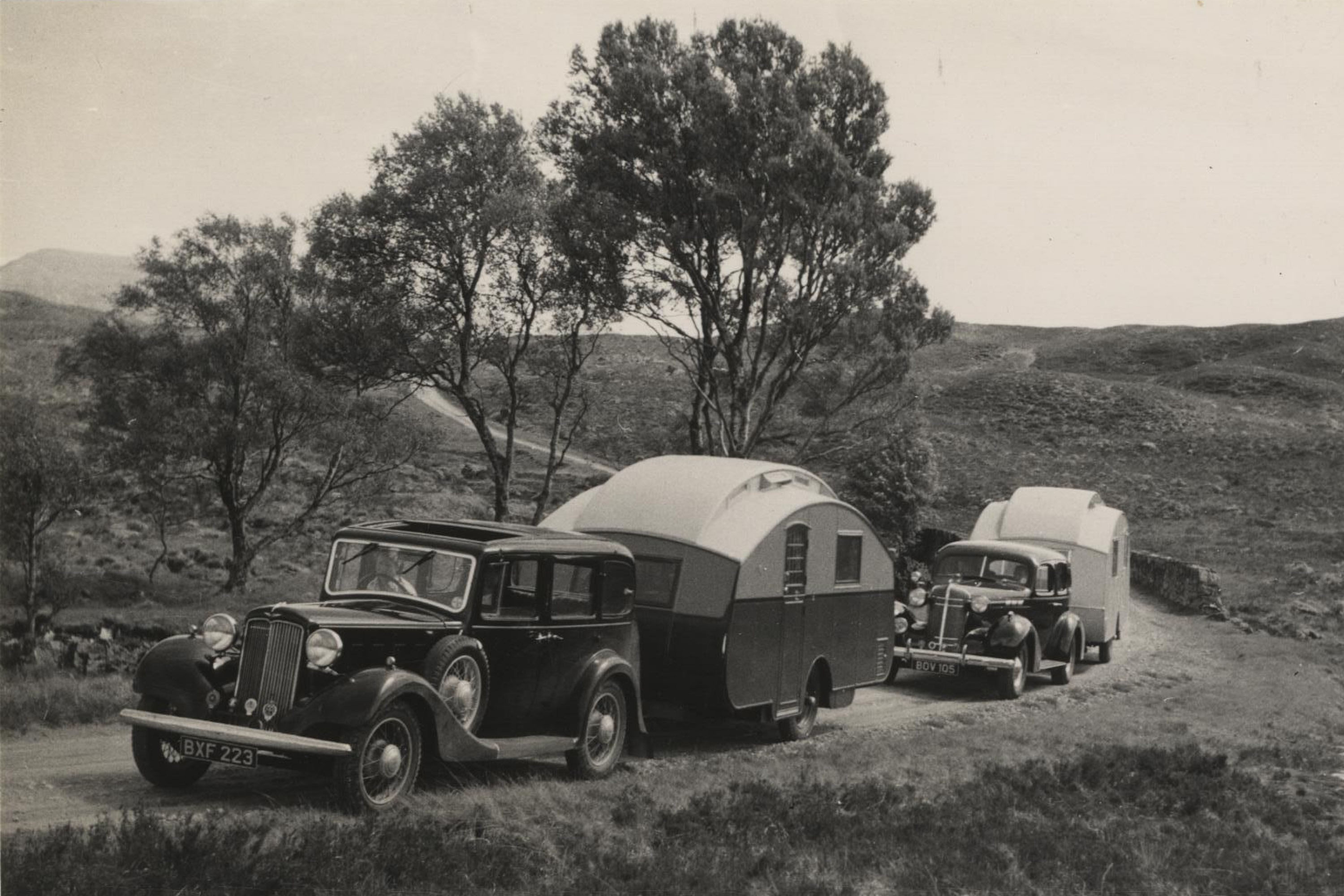 Two cars and caravans touring through Scotland