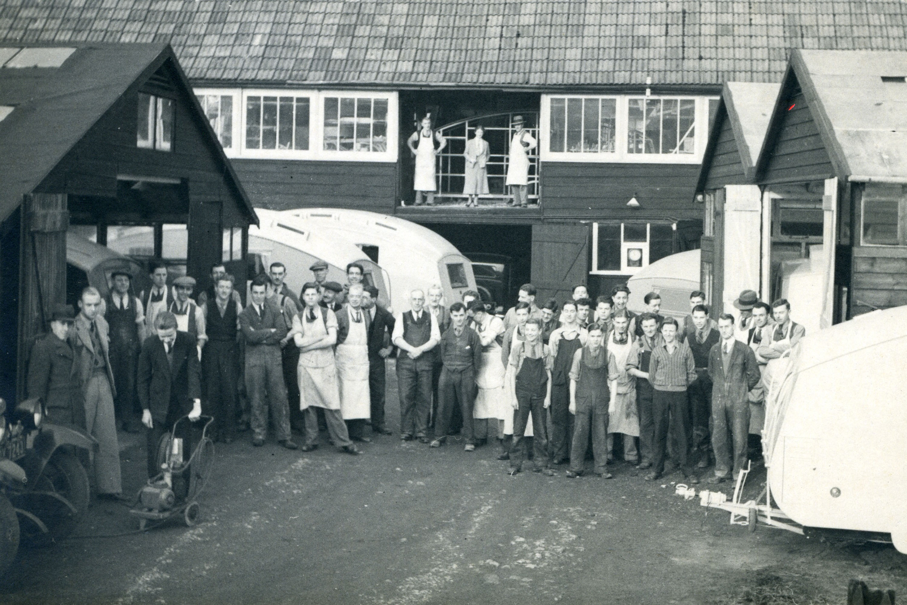 A view of a caravan workshop with employees