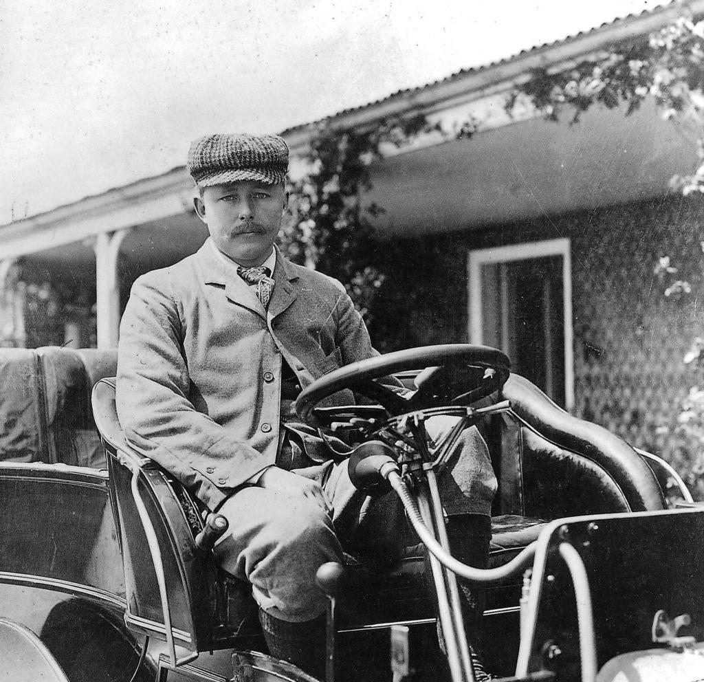 John Scott Montagu sitting in vehicle