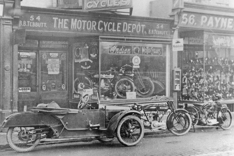 Early vehicles outside Tebbutt's Motor Cycle Depot shop