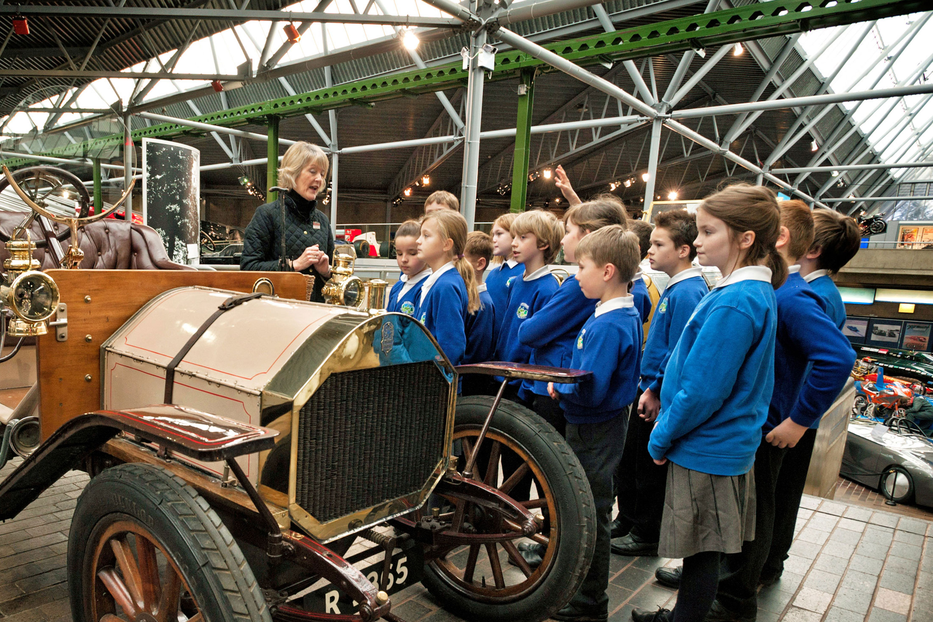 School children having an education session by Chitty Chitty Bang Bang in the National Motor Museum