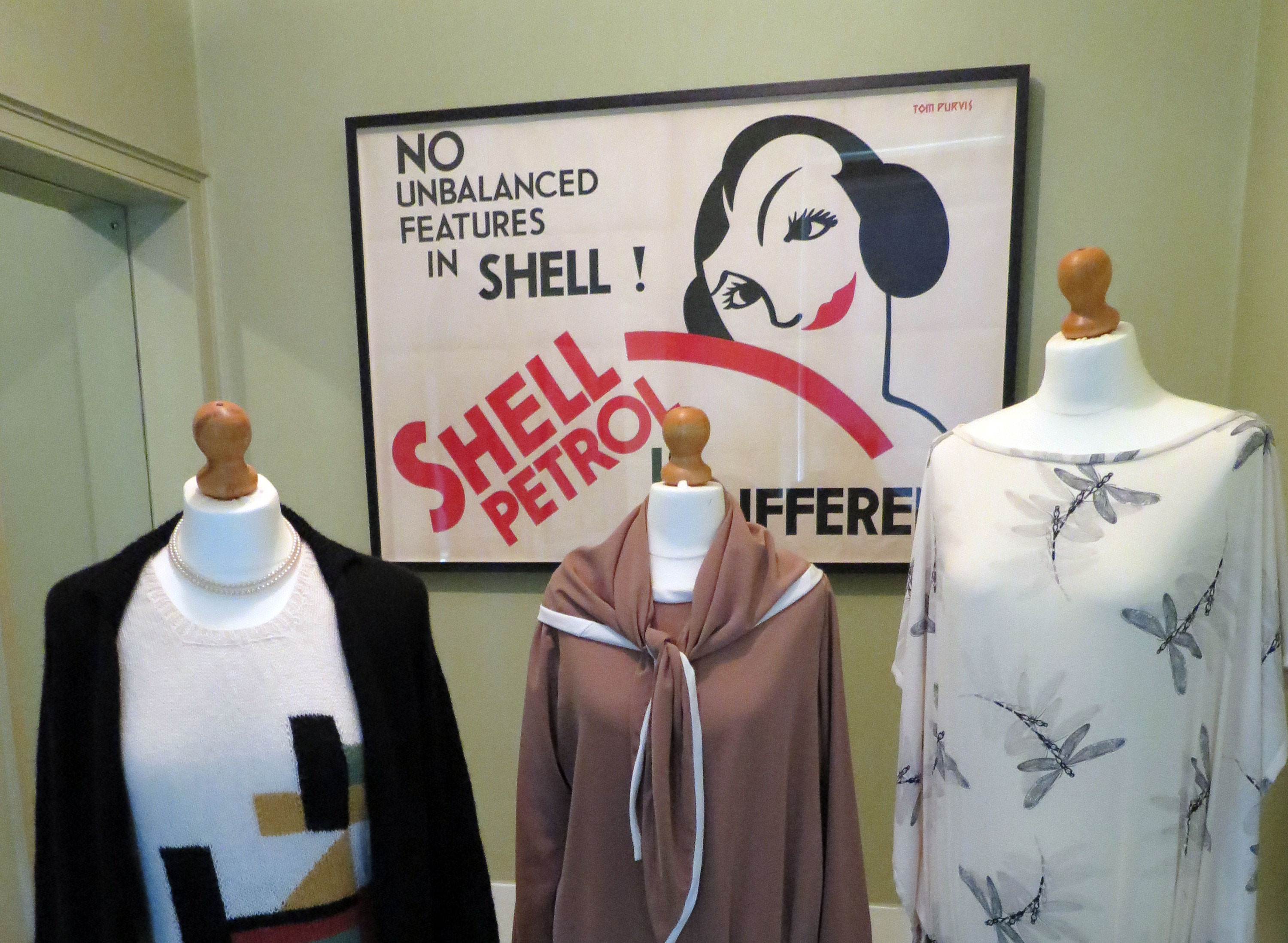 Upton House Exhibition 2018. 1930s Shell Poster behind costumes from the era