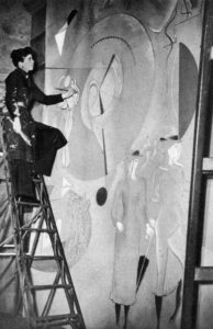 photograph of artist Mary Kessell painting a mural for Shell BP Pavilion at the Empire Exhibition in Glasgow 1938
