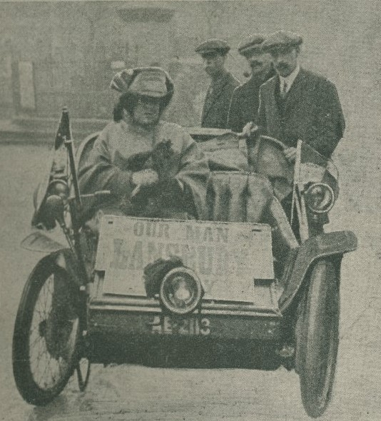 Suffragette driving car in support of MP George Lansbury