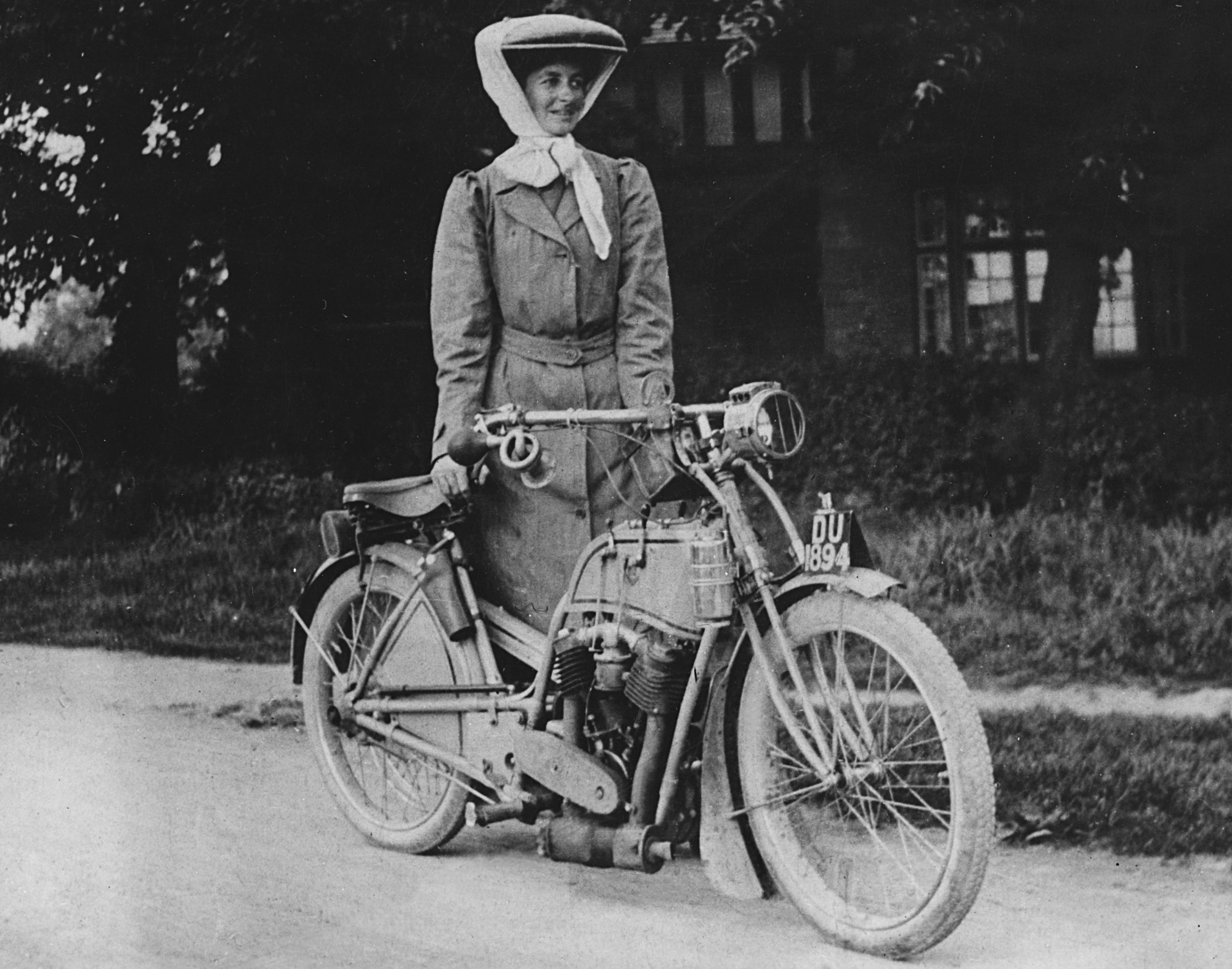 Muriel Hind dressed in cycling attire with Rex Motorcycle