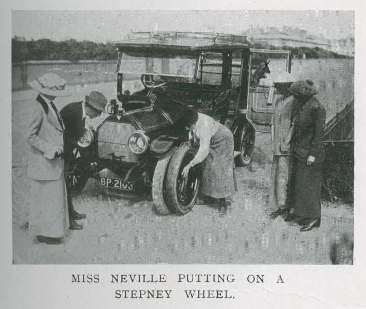 Image from the Car Illustrated of Miss Neville putting on a car wheel