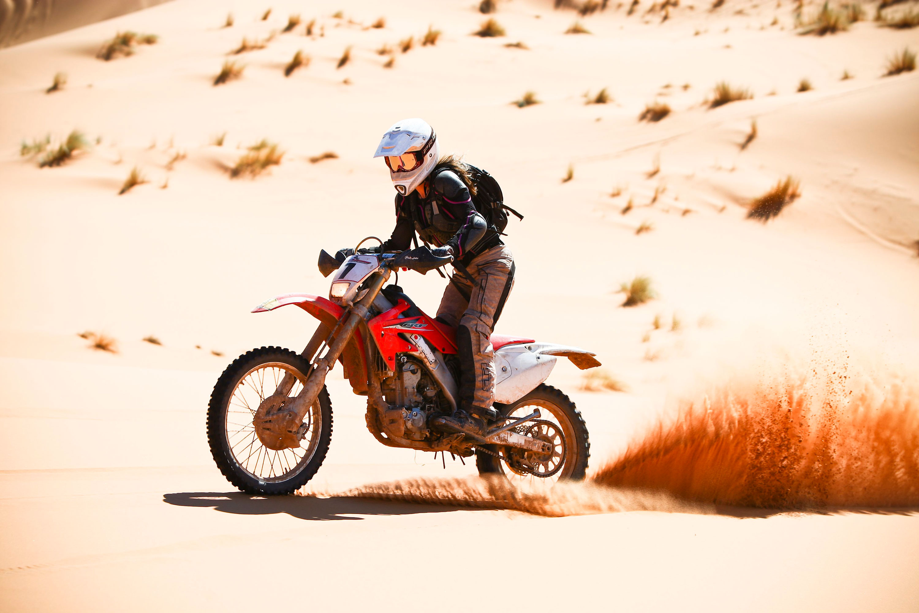 Steph Jeavons riding motorcycle in the desert