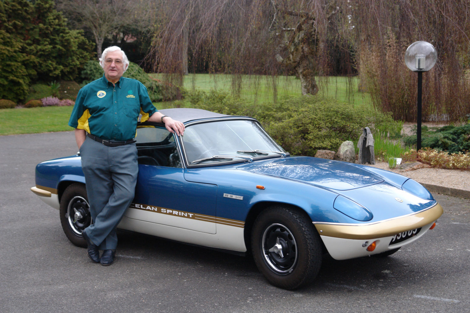 Ron Hickman leaning next to the Lotus Elan