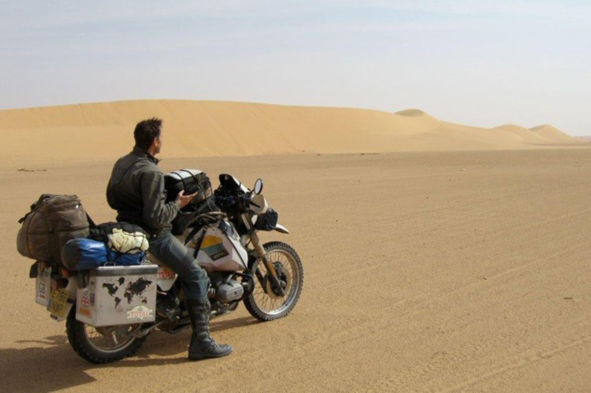 Pat Garrod on motorbike in desert