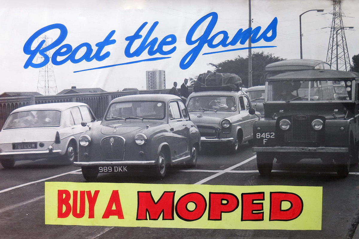 Poster of traffic on bridge with caption beat the James Buy a Moped