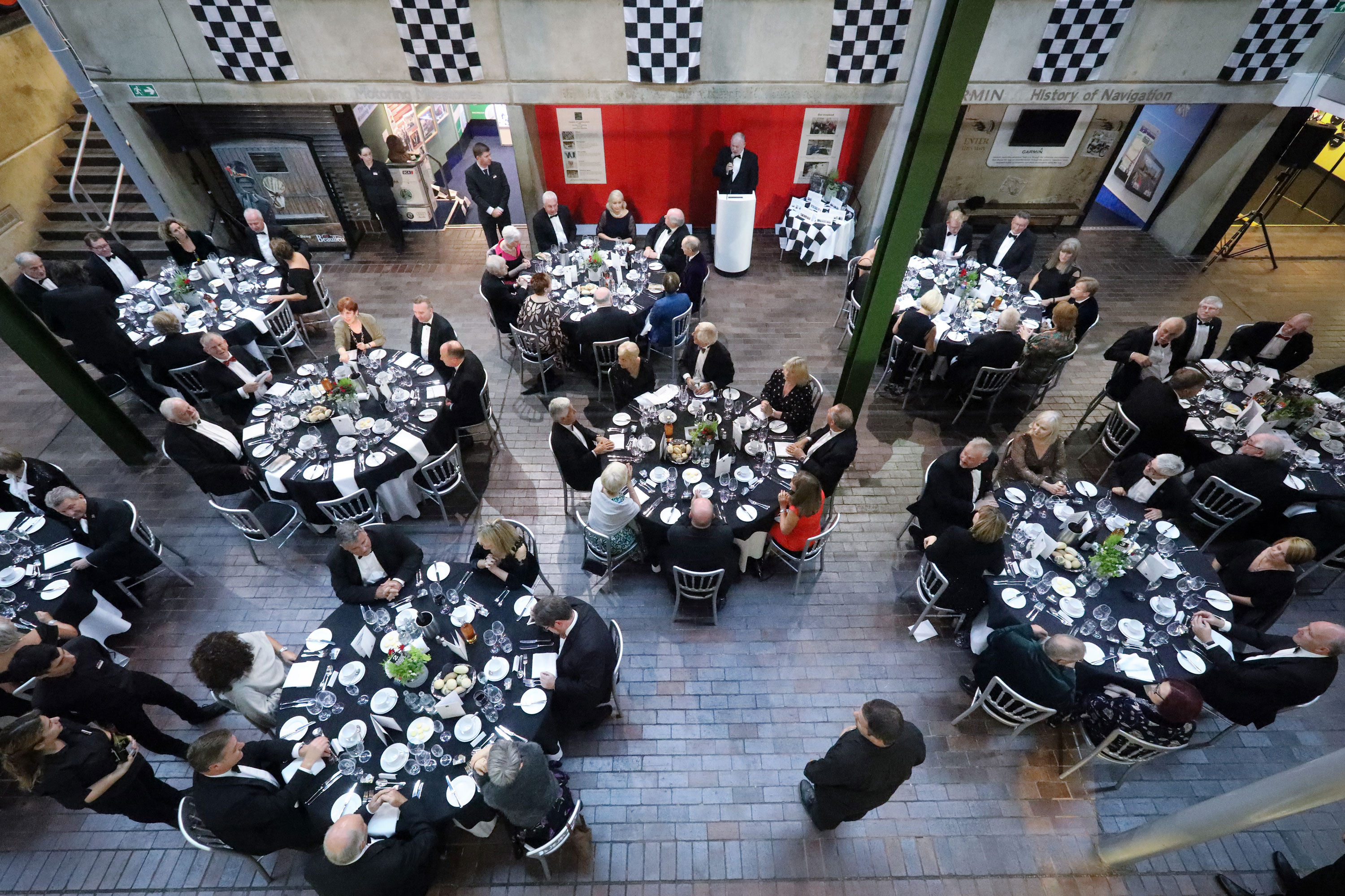 B100 dinner 2019 guests seated at table