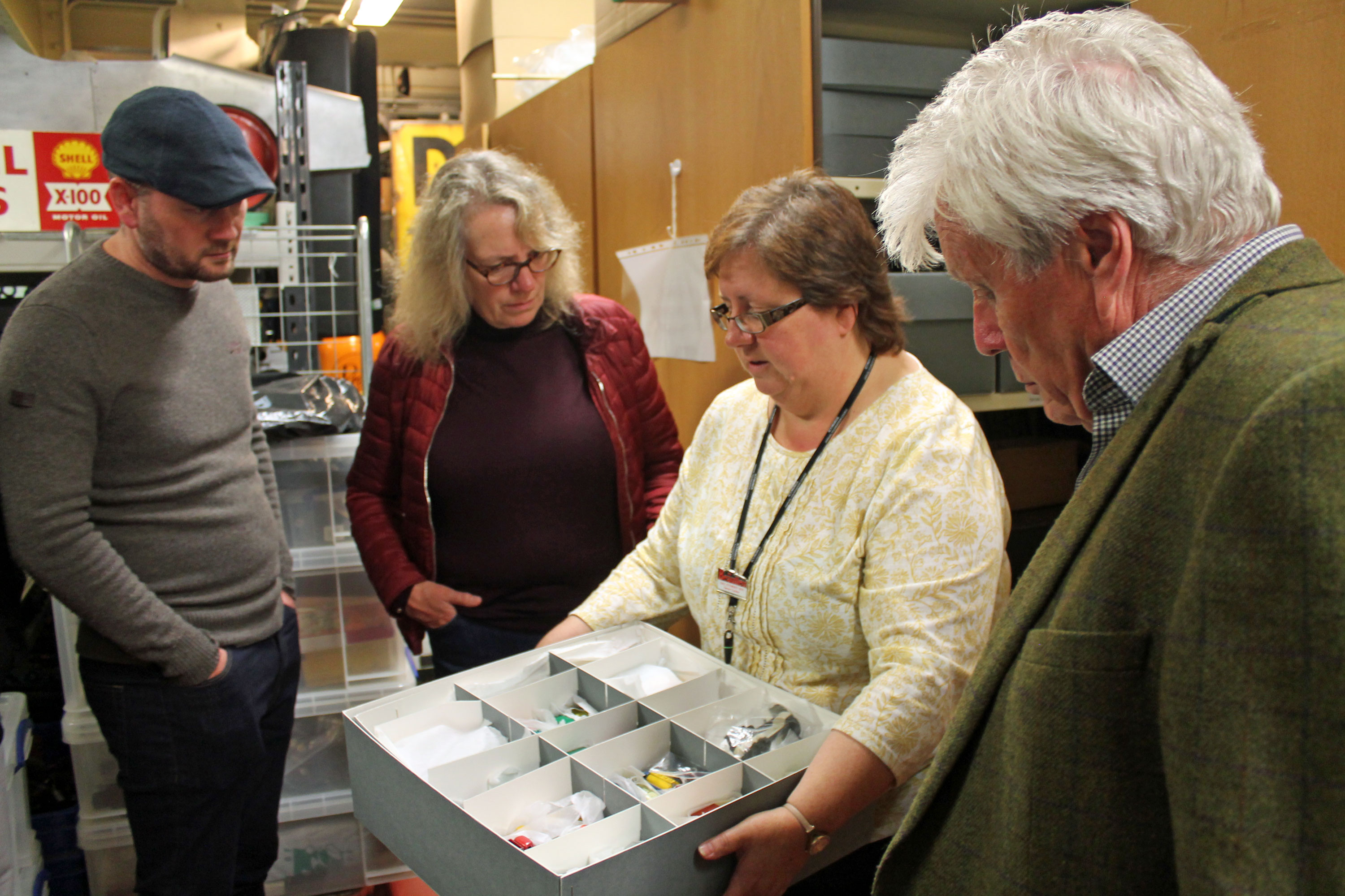 B100 tour of the Collections centre with guests looking at model cars