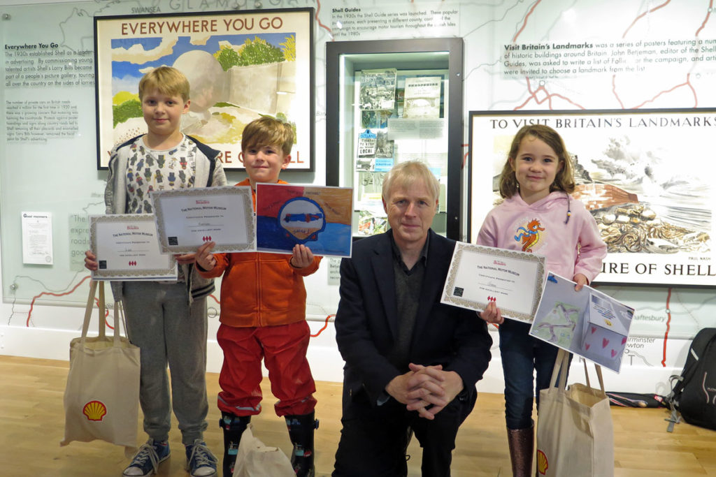 Lord Montague with Creative Fun competition winners in the National Motor Museum