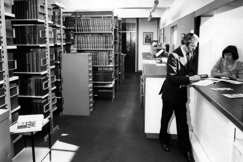 Librarian Peter Brooks in the new library located in the John Montagu Building, 1972