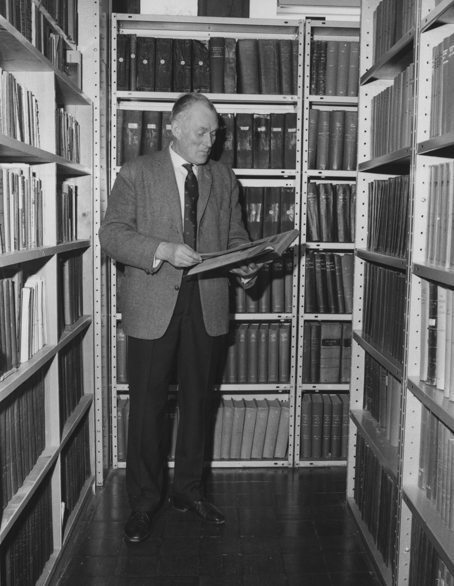 Librarian Eric Bellamy in Palace House, 1960s