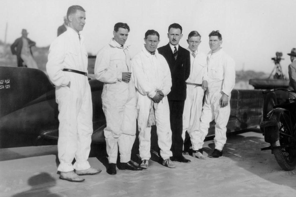 Mechanics in overalls with Golden Arrow