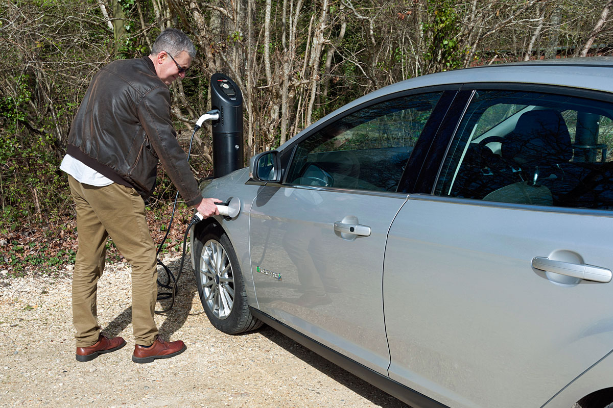 MAn charging an electric Ford Focus